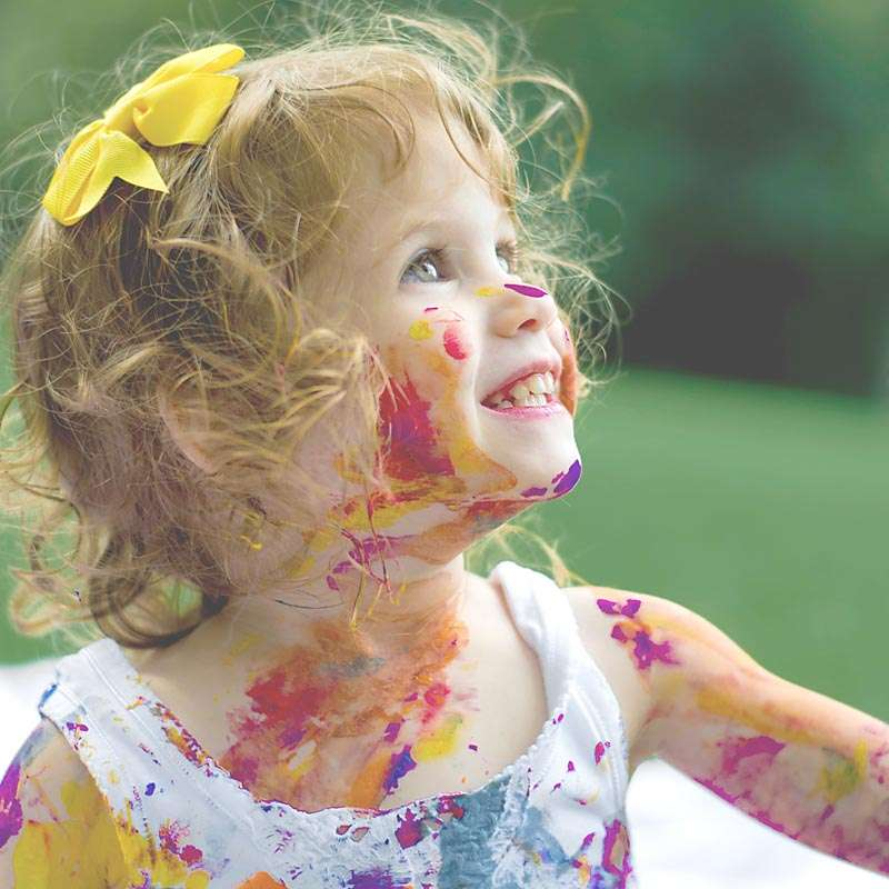 Girl grinning covered in paint doesnt mean youre a failure as a mom